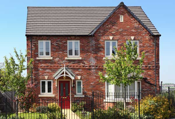 New build detached red brick house with railings